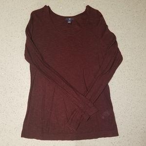 Maroon long-sleeve sweater.